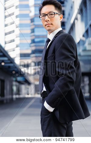 Businessman standing outdoors in city business district