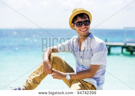 Young man at the beach wearing casual clothing. Isla Mujeres, Cancun, Mexico.