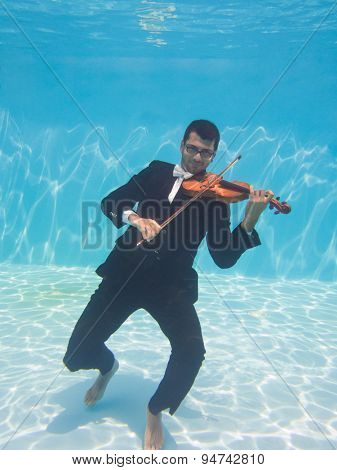 Aquatic music underwater violinist in suit
