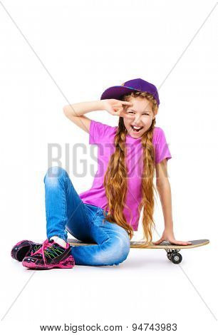 Pretty girl teenager wearing casual clothes posing with her skateboard. Active lifestyle. Studio shot. Isolated over white.