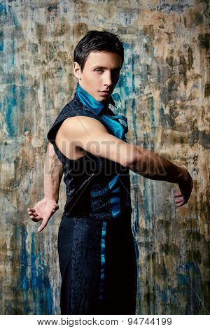 Portrait of a handsome man ballet dancer. Show-ballet. Latin American dances.