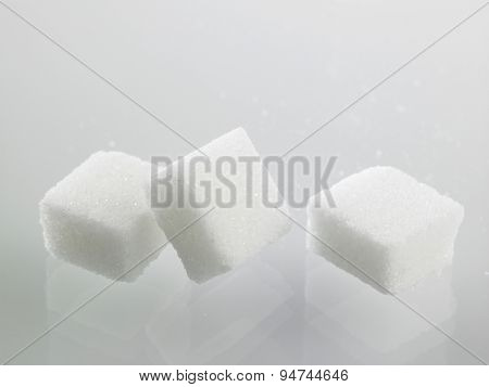 cube sugar on the gray background