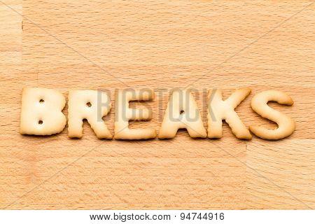 Word break biscuit over the wooden background