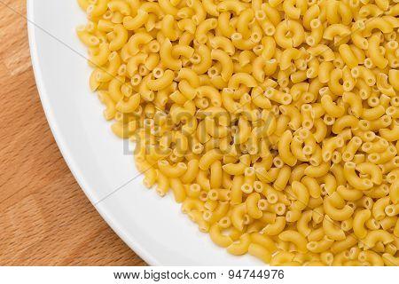 Italian Macaroni Pasta raw food on white plate