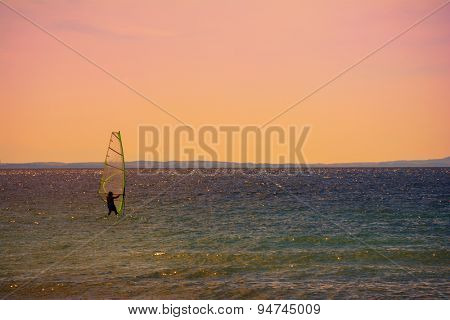 Windsurfing on the sea at sunset