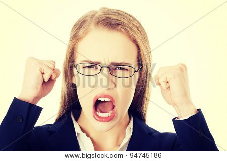 Angry young blonde businesswoman shouting