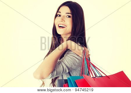 Happy beautiful teenager after shopping