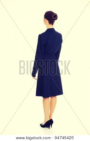 Businesswoman standing back to camera