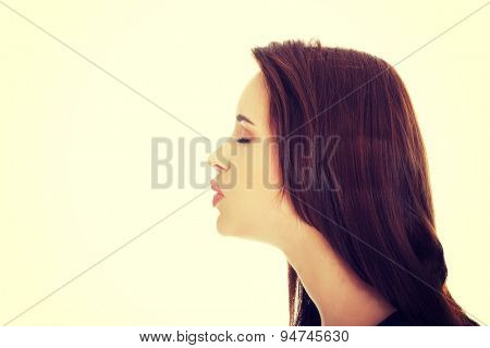 Beautiful young woman giving kiss