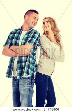 Happy young couple folded arms