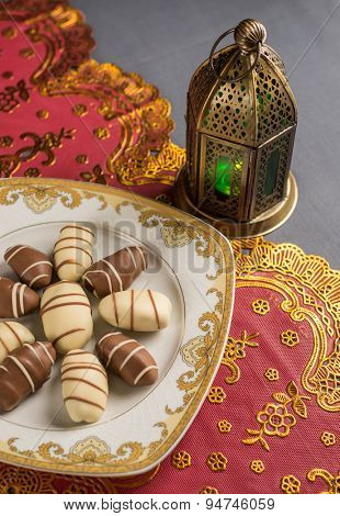 Fine arabic date chocolates and ramadan lamp.
