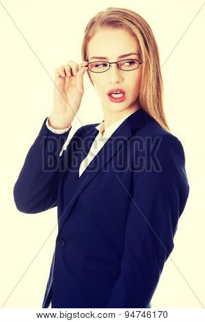 Blonde businesswoman holding her glasses