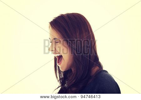 A very frustrated and angry woman screaming.