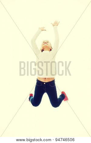 Little pretty girl jumping with joy