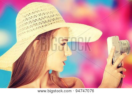 Young beautiful woman making photos
