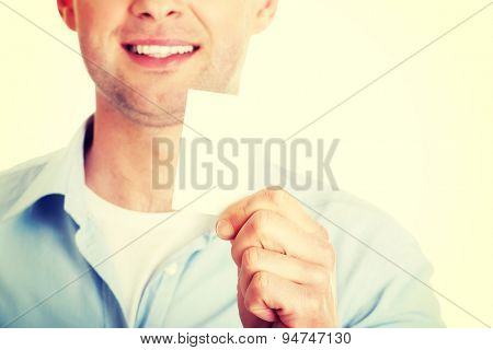 Businessman showing blank business card.
