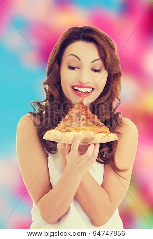 Happy beautiful woman eating pizza