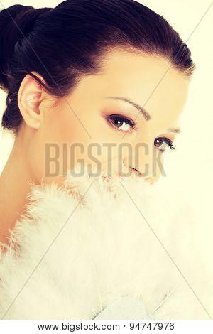 Beautiful woman holding white feathers