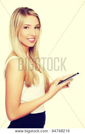Young blonde woman with a tablet