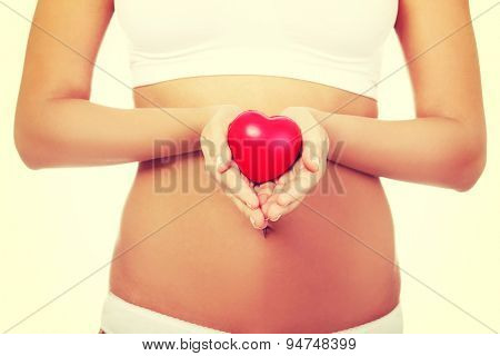 Woman holding heart in hands