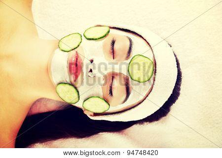 Young beautiful woman enjoying spa
