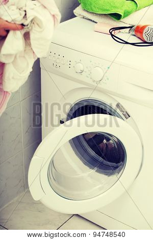 Woman do washing in a washing machine