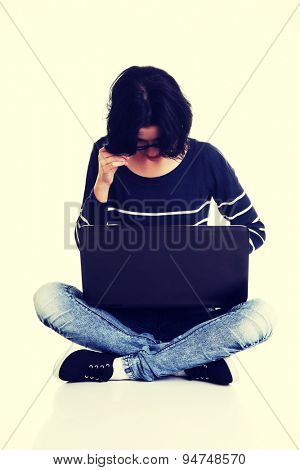 Sitting woman surfing the Internet