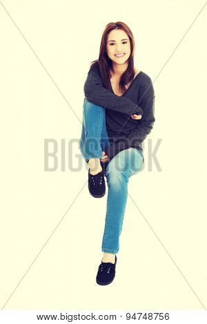 Young happy casual woman style. Studio portrait.