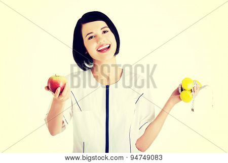 Happy nutritionist holding lifts and apple