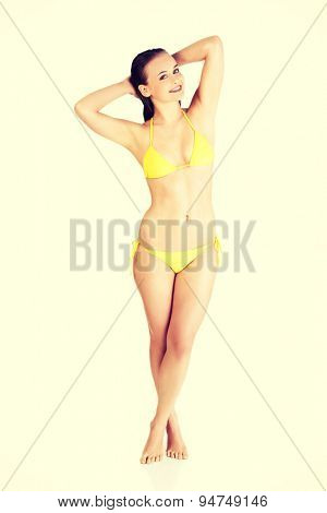 Beautiful woman in yellow swimsuit