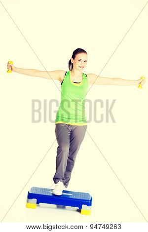 Active woman working out on step