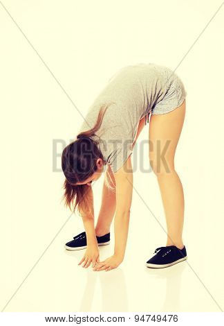 Young beautiful caucasian woman stretching