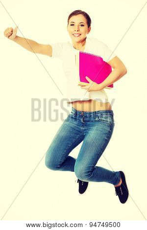 Young beautiful happy woman jumping