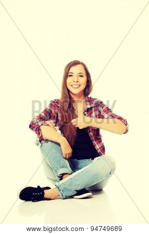 Happy woman sitting cross legged