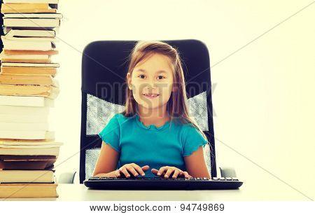 Cute little girl as a businesswoman