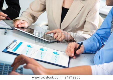 Group of businesspeople busy discussing financial matter during meeting