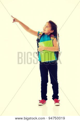 Little girl holding notebooks and backpack