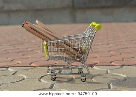 mini shopping cart with pencils outdoor