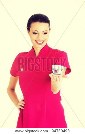 Happy visage artist holding cream container