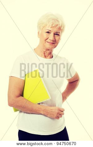 Happy senior woman holding a note