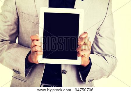 Handsome african man holding a tablet