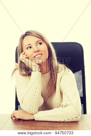 Young beautiful woman sitting at work