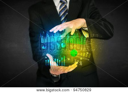 Businessman holding a shining diagram cloud in front of his body