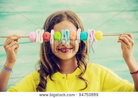 Happy young girl with sweets