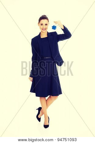 Happy attractive businesswoman, real estate agent, holding a house key
