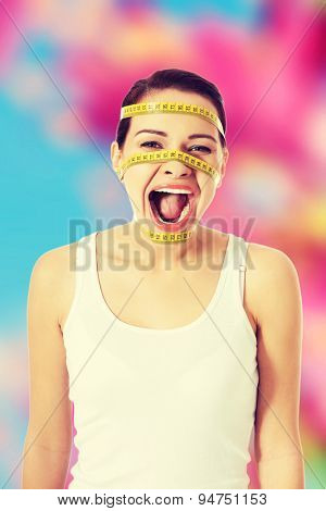 Screaming woman with a measure on her face