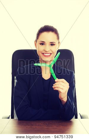 Green energy concept. Businesswoman with windmill