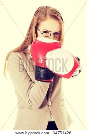 Beautiful woman wearing boxer gloves