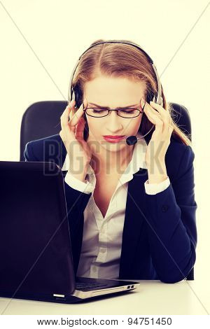Beautiful businesswoman with head pain