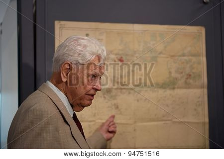 ST. PETERSBURG, RUSSIA - JUNE 24, 2015: Honorary member of Russian Geographical Society military hydrographer Nikolay Neronov on the exhibition